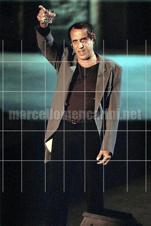 "Milan, October 28, 1999. Italian pop singer Adriano Celentano on the set of his TV program ""Francamente me ne infischio"" / Milano, 28 ottobre 1999. Il cantante Adriano Celentano sul set del suo programma televisivo ""Francamente me ne infischio"" - © Marcello Mencarini"