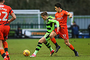 Forest Green Rovers Charlie Cooper(15) under pressure from Wycombe Wanderers Luke O'Nien(17) during the EFL Sky Bet League 2 match between Forest Green Rovers and Wycombe Wanderers at the New Lawn, Forest Green, United Kingdom on 1 January 2018. Photo by Shane Healey.