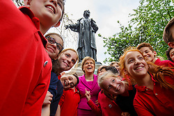 © Licensed to London News Pictures. 23/05/2016. London, UK. Scottish First Minister and Leader of the SNP Nicola Sturgeon meets pupils of The Independent Jewish Day School in front of Emmeline Pankhurst memorial statue in Victoria Tower Gardens in London on Monday, 23 May 2016 after a photocall to make the progressive case in favour of a Remain vote in next month's EU Referendum. Photo credit: Tolga Akmen/LNP