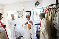 ROME, ITALY - 26 AUGUST 2016: Father Sebastian Vazhakala, co-founder of the Missionaries of Charity-Contemplative, prepares for the evening mass in the sacristy of the chapel of Casa Serena, a prefabricated house for homeless men in Rome, Italy, on August 26th 2016.<br /> <br /> Casa Serena, inaugurated in 1993, hosts approximately 70 men, 50 years or above, of any nationality, religion, colour. <br /> <br /> The Missionaries of Charity-Contemplative is a diocesan religious Institute composed of Brothers and priests with equal rights and obligations, founded by Blessed Teresa of Calcutta with Fr. Sebastian Vazhakala in 1979. The members take public vows of Chastity, Poverty, Obedience and free service to the poor.<br /> <br /> Mother Teresa, also known as Blessed Teresa of Calcutta, was an Albanian Roman Catholic nun and missionary. She founded the Missionaries of Charity, a Roman Catholic religious congregation, whose members must adhere to the vows of chastity, poverty, and obedience, as well as the vow to give wholehearted free service to the poorest of the poor. Shortly after she died in 1997, Pope John Paul II waived the usual five-year waiting period and allowed the opening of the process to declare her sainthood. She was beatified in 2003. A second miracle was credited to her intercession by Pope Francis, in December 2015, paving the way for her to be recognised as a saint by the Roman Catholic Church. Her canonisation is scheduled for September 4th 2016, a day before the 19th anniversary of her death.