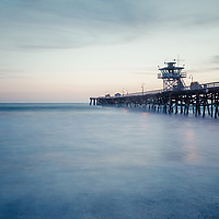 San Clemente pier at dusk photo. San Clemente California is a popular coastal beach city along the Pacific Ocean n the United States of America. Photo is high resolution. Copyright ⓒ 2017 Paul Velgos with All Rights Reserved.