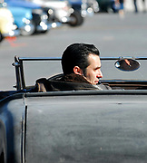 A young Rockabilly guy driving away in a Hotrod, Viva Las Vegas Festival, Las Vegas, USA 2006.