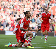 Picture by Paul Terry/Focus Images Ltd +44 7545 642257<br /> 28/09/2013<br /> Dani Osvaldo ( C ) of Southampton celebrates with Adam Lallana ( L ) after scoring the opening goal during the Barclays Premier League match at the St Mary's Stadium, Southampton.