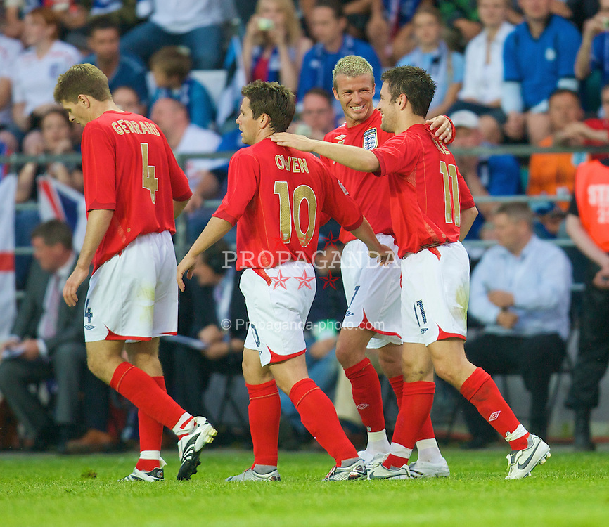 Tallinn, Estonia - Wednesday, June 6, 2007: England's Joe Cole celebrates scoring the opening goal against Estonia with team-mates Michael Owen and David Beckham during the UEFA Euro 2008 Qualifying Group E match at Le Coq Arena. (Pic by David Rawcliffe/Propaganda)