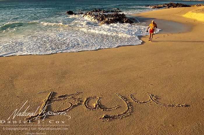 Baja written in the sand near the ocean. Mexico.