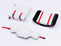 """October 4, 2017 - inconnu - Here's a work station designed to make night shift office workers more comfortable.It is also meant to be useful for people who work from home.Called the New Normal, the set consists of accessories designed to make work more comfortable and playfulIt is made up of a removable backrest which has multiple functionality as a wrap-around hooded blanket.A moveable pillow plays soothing pre-recorded sounds and a rocking foot ramp.Chicago-based product designer Si Chen said she was inspired to create New Normal because with work life becoming more digitally accessible. She added:"""" Having the ability to set up and work anywhere is becoming more and more popular with the increase of co-working spaces. """"She said the problem was that he majority of these spaces were often confined and isolated and can feel """"stressful"""" .She wanted to provide """"soothing and energizing elements to make any work space more comfortable"""".The New Normal foot ramp can give people both a foot rest and foot exercise. The foot rest is made form memory foam for added comfort mounted on a wooden rocker.The rocking motion can help soothe stressThe pillow is designed to be used as both an arm rest and for power-napping. The pillow also plays pre- recorded environmental sounds to help the user relax and decompress.Chen says she designs products that combine technology and textiles, to create comfortable objects, that can transform peoples' behaviour and lifestyle.She also has a new project, the Whisper Pillow which allows users to record their secrets into to be shared with themselves. # UN KIT POUR DORMIR AU BUREAU (Credit Image: © Visual via ZUMA Press)"""