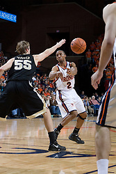 Virginia's J.R. Reynolds (2) passes around Wake Forest's Kyle Visser (55). Reynolds tallied a career high 40 points as the Virginia Cavaliers defeated the Wake Forest Demon Decons 88-76 at the John Paul Jones Arena in Charlottesville, VA on January 21, 2007.