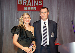 CARDIFF, WALES - Tuesday, October 4, 2011: Wales' Amy Lea is presented with the Club Player of the Year Award by manager Jarmo Matikainen at the FAW Footballer of the Year Awards 2011 held at the Wales National Museum. (Pic by David Rawcliffe/Propaganda)