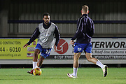 AFC Wimbledon midfielder Tom Soares (19) and AFC Wimbledon midfielder Mitchell (Mitch) Pinnock (11) warming up during the EFL Trophy group stage match between AFC Wimbledon and Stevenage at the Cherry Red Records Stadium, Kingston, England on 6 November 2018.