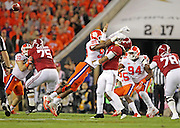 Clemson Tigers defensive end Clelin Ferrell (99) is called for a late hit on Alabama Crimson Tide quarterback Jalen Hurts (2) in the first half of the National Championship game at Raymond James Stadium in Tampa, Monday, January 9, 2017.
