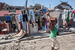 October 7, 2016 - Les Cayes, Haiti - A woman walks on the street of Les Cayes, Haiti, that was badly affected by the hurricane, on October 7, 2016. Hurricane Matthew killed almost 900 people and displaced tens of thousands in Haiti before plowing northward on Saturday just off the southeast U.S. coast, where it caused major flooding and widespread power outages. (Credit Image: © Bahare Khodabande/NurPhoto via ZUMA Press)