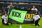 """Villa fans display their """"kick it out"""" flag on the pitch during the EFL Sky Bet Championship match between Aston Villa and Reading at Villa Park, Birmingham, England on 3 April 2018. Picture by Dennis Goodwin."""