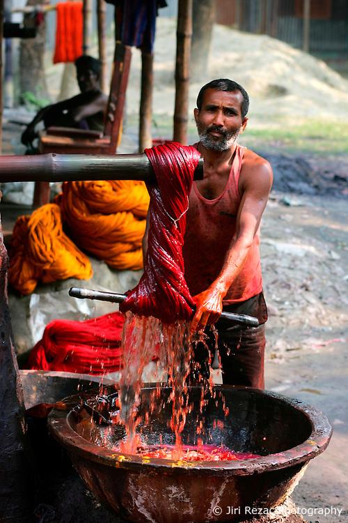 BANGLADESH SIRAJGANJ RADHUNIBARI 30JAN07 - Labourer dyes cotton yarn. Records of an indigenous weaving industry based on handlooms producing cotton fabrics date back to the 13th century in this area...jre/Photo by Jiri Rezac..© Jiri Rezac 2007..Contact: +44 (0) 7050 110 417.Mobile:  +44 (0) 7801 337 683.Office:  +44 (0) 20 8968 9635..Email:   jiri@jirirezac.com.Web:    www.jirirezac.com..© All images Jiri Rezac 2007 - All rights reserved.