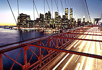The skyline of lower Manhattan as seen from the Brooklyn Bridge at dusk.