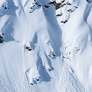 Logan Pehota spins off a cliff at the Freeride World Tour in Haines, Alaksa