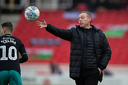 STOKE-ON-TRENT, ENGLAND - Saturday, January 25, 2020: Swansea City's manager Steve Cooper tries to catch the ball during the Football League Championship match between Stoke City FC and Swansea City FC at the Britannia Stadium. (Pic by David Rawcliffe/Propaganda)