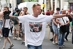 © Licensed to London News Pictures. 09/06/2018. London, UK. Protesters clash with police. Thousands of supporters of EDL founder Tommy Robinson ( real name Stephen Yaxley-Lennon ) demonstrate in Westminster after Robinson was convicted of Contempt of Court . Robinson was already serving a suspended sentence for Contempt of Court over a similar incident , when he was convicted on Friday 25th May 2018 . Photo credit: Joel Goodman/LNP