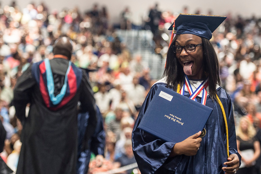 LYNCHBURG, VA - June 11: Shy-Lyn Austin sticks her tongue out at friends and family after getting her diploma at Heritage High School's graduation on Sunday, June 11, 2017 in Lynchburg, Va. (Photo by Jay Westcott/The News & Advance)
