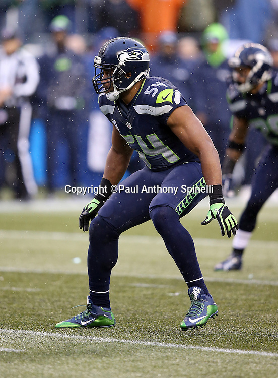 Seattle Seahawks middle linebacker Bobby Wagner (54) makes a move during the 2015 NFL week 16 regular season football game against the St. Louis Rams on Sunday, Dec. 27, 2015 in Seattle. The Rams won the game 23-17. (©Paul Anthony Spinelli)