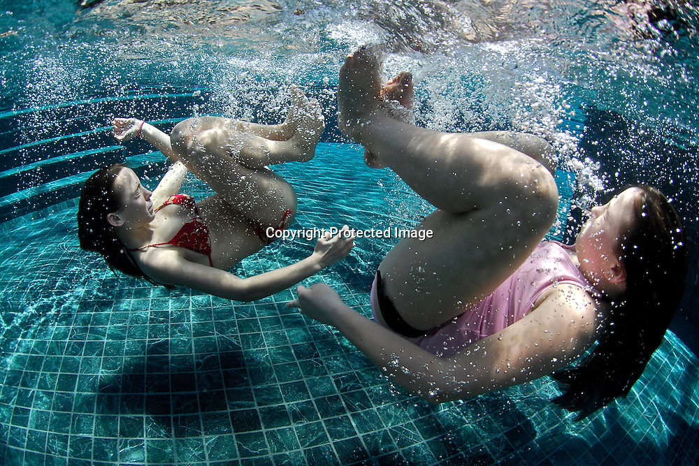 The daughters of Frank Risso, who co-owns two houses on the development at Peninsula Papagayo play underwater at the Beach Club in the development's beach front pool.Frank Risso's daughters Samantha Rizzo (red bikini) (14) and Bess Rizzo (10).