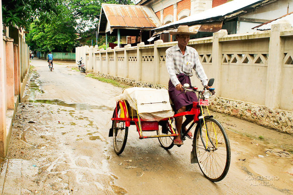 Man driving trishaw in Mandalay