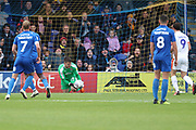 AFC Wimbledon goalkeeper Joe McDonnell (24) saving penalty from Luton Town attacker Danny Hylton (9) during the EFL Sky Bet League 1 match between AFC Wimbledon and Luton Town at the Cherry Red Records Stadium, Kingston, England on 27 October 2018.