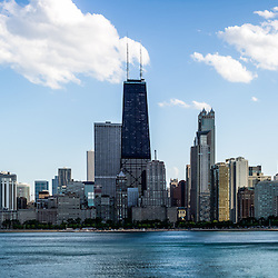 Panorama of Chicago skyline with the Hancock building and other popular downtown Chicago city buildings. The John Hancock Center building is one of the world's tallest skyscrapers and is a famous fixture in the Chicago skyline. Image panoramic ratio is 3:1 and is high resolution.