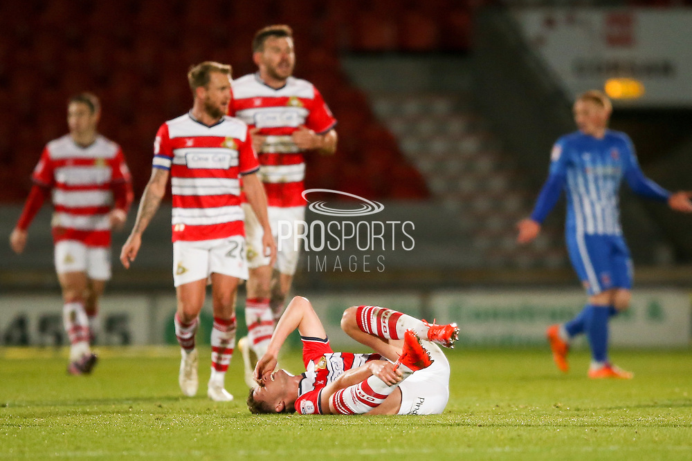 Doncaster Rovers midfielder, on loan from Chelsea, Jordan Houghton (16) feels a knock during the EFL Sky Bet League 2 match between Doncaster Rovers and Hartlepool United at the Keepmoat Stadium, Doncaster, England on 19 November 2016. Photo by Simon Davies.
