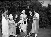 15/05/1959<br /> 05/15/1959<br /> 15 May 1959<br /> International Folk dancers at Wills tobacco factory. About sixty folk dancers from France, Denmark, India, Netherlands, Switzerland and Ireland, who were performing at the National Stadium, toured the W.D. & H.O. Wills factory at South Circular Road, Dublin. Afterwards they gave a performance in the factory garden. Picture shows dancers (from left) from India, France, Denmark, Netherlands, Ireland and Switzerland signing autographs for their WillsGuide Kay Kenny.