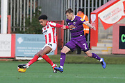 Jacob Maddox and Jake Hessenthaler  during the EFL Sky Bet League 2 match between Cheltenham Town and Grimsby Town FC at LCI Rail Stadium, Cheltenham, England on 8 December 2018.