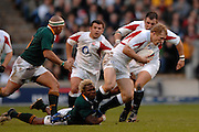 Twickenham, GREAT BRITAIN, Josh LEWSEY is caught by the low tackle from Kamamba FLOORS, during the, Investec 2006 Rugby Challenge, England vs South Africa, at Twickenham Stadium, ENGLAND on Sat 25.11.2006. [Photo, Peter Spurrier/Intersport-images]