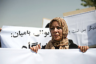 A woman holding a banner demanding to stop violence against women in a protest organized by 'Young women for change', a human rights organization demanding to stop gender based violence.