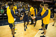 March 5, 2018 - Asheville, North Carolina - U.S. Cellular Center: ETSU guard Jermaine Long (24), ETSU guard Bo Hodges (3), ETSU center Karl Overstreet (34), ETSU guard Dillon Reppart (23)<br /> <br /> Image Credit: Dakota Hamilton/ETSU