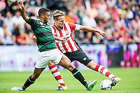 EINDHOVEN - PSV - FC Groningen , Voetbal , Seizoen 2015/2016 , Eredivisie , Philips stadion , 16-08-2015 , FC Groningen speler Johan Kappelhof (l) in duel met PSV speler Luuk de Jong (r)