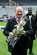 Newcastle United manager Rafael Benitez holds up the EFL Sky Bet Championship trophy following the EFL Sky Bet Championship match between Newcastle United and Barnsley at St. James's Park, Newcastle, England on 7 May 2017. Photo by Craig Doyle.