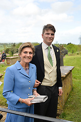 The Bride's mother PRINCESS VICTORIA VON PREUSSEN and her son PRINCE FRITZI VON PREUSSEN  at the wedding of Princess Florence von Preussen second daughter of Prince Nicholas von Preussen to the Hon.James Tollemache youngest son of the 5th Lord Tollemache held at the Church of St.Michael & All Angels, East Coker, Somerset on 10th May 2014.