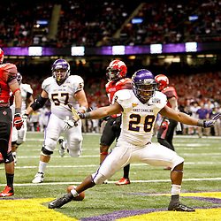 December 22, 2012; New Orleans, LA, USA; East Carolina Pirates wide receiver Justin Hardy (2) celebrates after scoring a touchdown against the Louisiana-Lafayette Ragin Cajuns during the second half of the New Orleans Bowl at the Mercedes-Benz Superdome. UL-Lafayette defeated East Carolina 43-34. Mandatory Credit: Derick E. Hingle-USA TODAY Sports