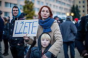 "A mother protesting with her child in front of  ""Top Hotel"" in Prague's quater Chodov. The sign reads ""You are lying"". They are protesting for European values and against the conference of the European anti-migrant parties ""Europe of Nations and Freedom"" (ENF). Attending were Marie Le Pen from France, Geert Wilders from Holland and Tomio Okamura of the Freedom and Direct Democracy (SPD) movement from Czech Republic which was hosting the meeting."