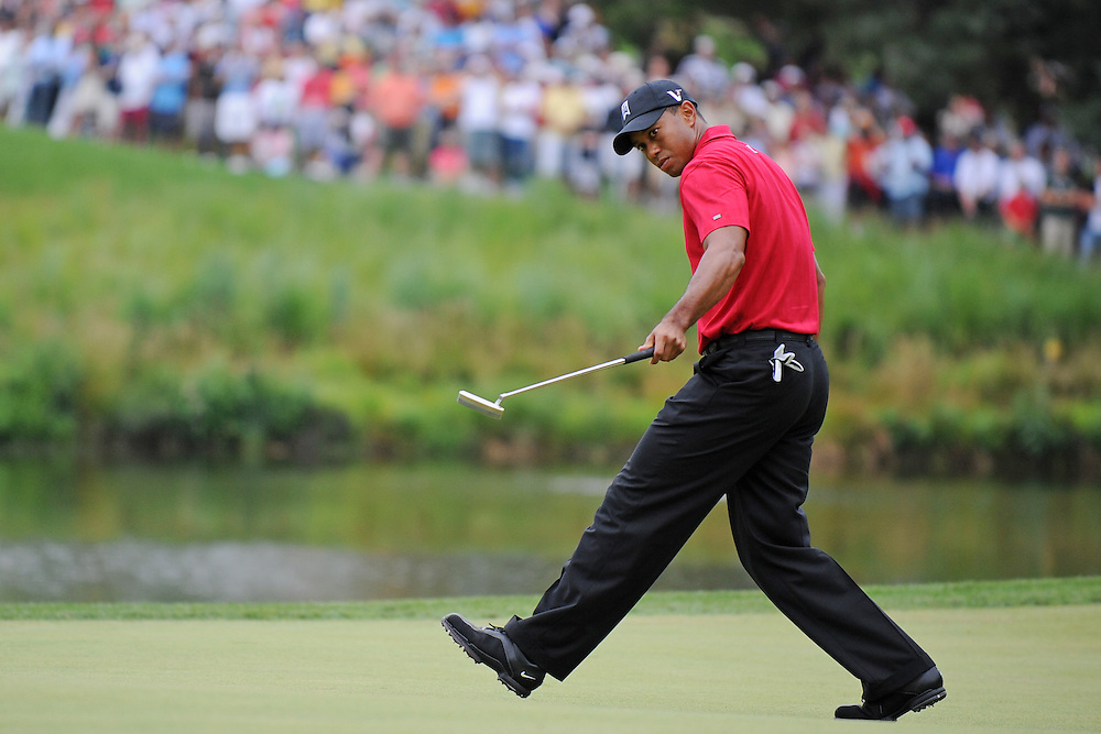 Tiger Woods of the US watches his putt roll in for a birdie on the 10th hole during the AT&T National golf tournament at Congressional Country Club in Bethesda, Maryland USA 05 July 2009. Woods won the event by shooting a 3 under par 67, beating Hunter Mahan by a stroke.