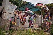 Festividad del Corpus Christi, representada en Venezuela a traves del ritual magico-religioso de los Diablos Danzantes. Los Diablos de Naiguata se identifican por pintar sus propios trajes y decorarlos con cruces, rayas y circulos, figuras que impiden que el maligno los domine. Las mascaras son en su gran mayoria animales marinos. Llevan escapularios cruzados, crucifijos y cruces de palma bendita. Naiguata, 23 Junio 2011. (ivan gonzalez)
