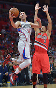 Los Angeles Clippers guard Austin Rivers #25 gets past Portland Trail Blazers guard C.J. McCollum #3 in the 4th quarter. The Portland Trail Blazers defeated the Los Angeles Clippers 108-98 in game 5 of the NBA Western Conference Playoffs first round. Los Angeles, CA.  April 27, 2016. (Photo by John McCoy/Southern California News Group)