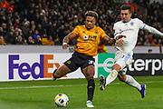 Adama Traore of Wolverhampton Wanderers & Vernon De Marco of Slovan Bratislava during the Europa League match between Wolverhampton Wanderers and Slovan Bratislava at Molineux, Wolverhampton, England on 7 November 2019.