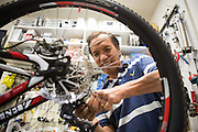 Peter Nguyen runs a new set of brake lines on a customer's mountain bike at Sun Bike Shop in Milpitas, Calif., on Sept. 18, 2012.  Nugyen has been a mechanic at Sun Bike Shop for 12 years.  Photo by Stan Olszewski/SOSKIphoto.