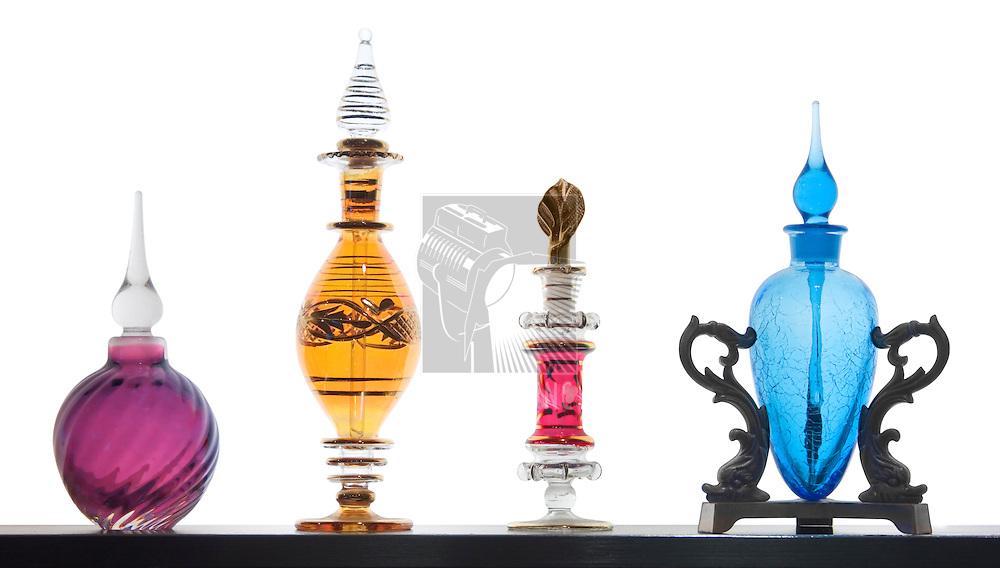 Exotic perfume bottles on white background