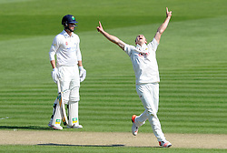 Surrey's Tom Curran celebrates the wicket of Glamorgan's Mark Wallace. - Photo mandatory by-line: Harry Trump/JMP - Mobile: 07966 386802 - 21/04/15 - SPORT - CRICKET - LVCC County Championship - Division 2 - Day 3 - Glamorgan v Surrey - Swalec Stadium, Cardiff, Wales.