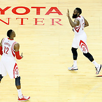 25 May 2015: Houston Rockets guard James Harden (13) celebrates with Houston Rockets center Dwight Howard (12) during the Houston Rockets 128-115 victory over the Golden State Warriors, in game 4 of the Western Conference finals, at the Toyota Center, Houston, Texas, USA.