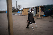 A disabled migrant is seen in the Calais refugees camp knowen as the Jungle walking to a food distribution, Calais, France. FEDERICO SCOPPA/CAPTA