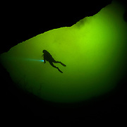 Scuba diving tourism is a possible way for islanders to gain income from a non-destructive use of the ponds.