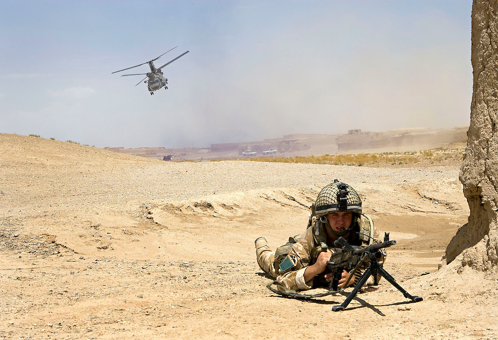 A British soldier of 3rd Battalion The Parachute Regiment takes up a fire positions to provide security for a Chinook Ch-47 helicopter during an airborne assault as part of Operation 'Southern Beast'. Kandahar Province, Afghanistan on the 3rd of August 2008.