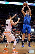Apr 9, 2017; Phoenix, AZ, USA; Dallas Mavericks forward Dirk Nowitzki (41) shoots the ball over Phoenix Suns center Alex Len (21) in the first half of the NBA game at Talking Stick Resort Arena. Mandatory Credit: Jennifer Stewart-USA TODAY Sports